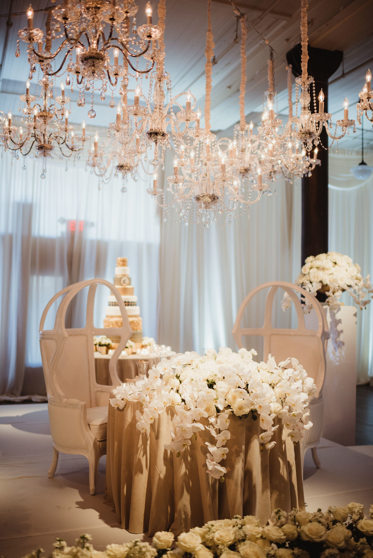 sweetheart table, white floral, chandeliers