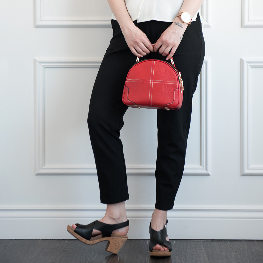 woman holding a red purse