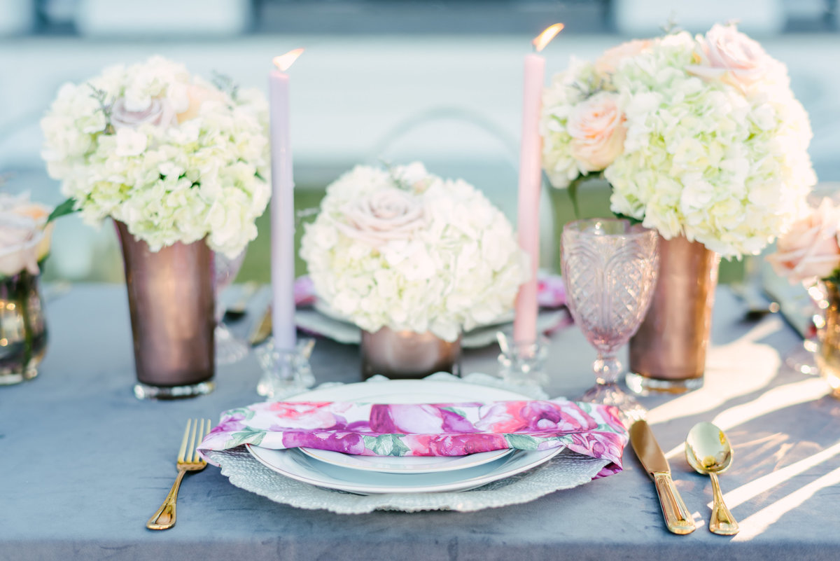 purple floral centerpiece and place setting