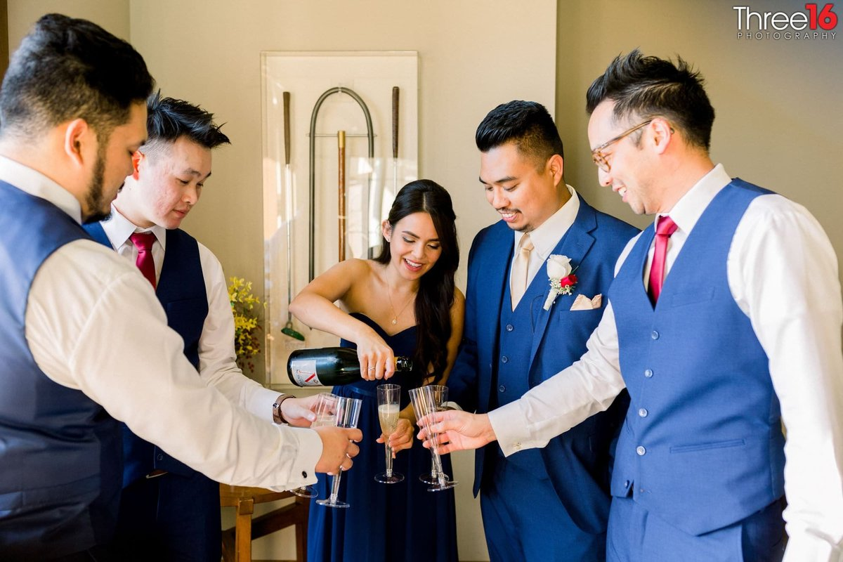 The Groom and his party share a pre-wedding drink together