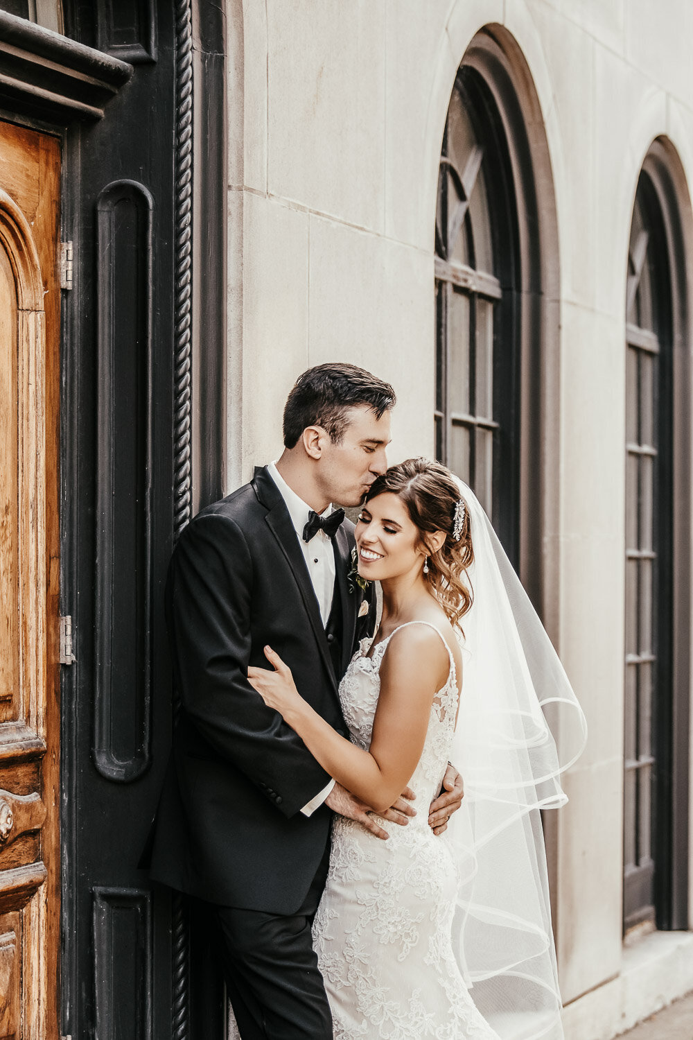 Bride & Groom kissing outside building in Buffalo, New York