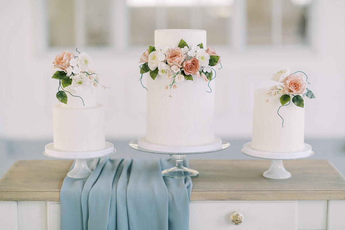 white fondant wedding cakes with sugar flowers