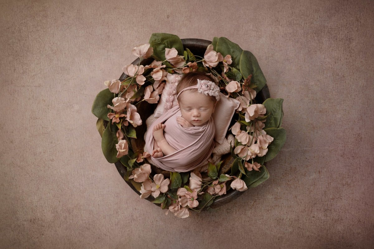 Little girl in a wreath of flowers