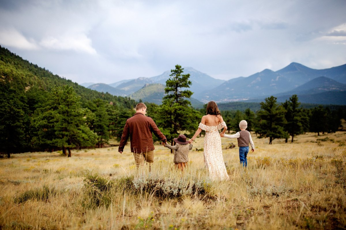 Family walking hand in hand in Summit County Colorado