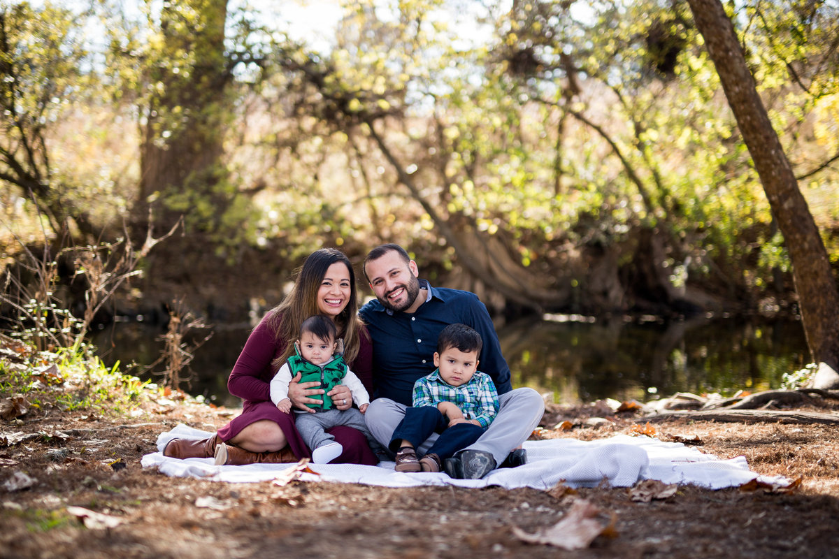family portrait on river bank by San Antonio Photographer Expose The Heart photography
