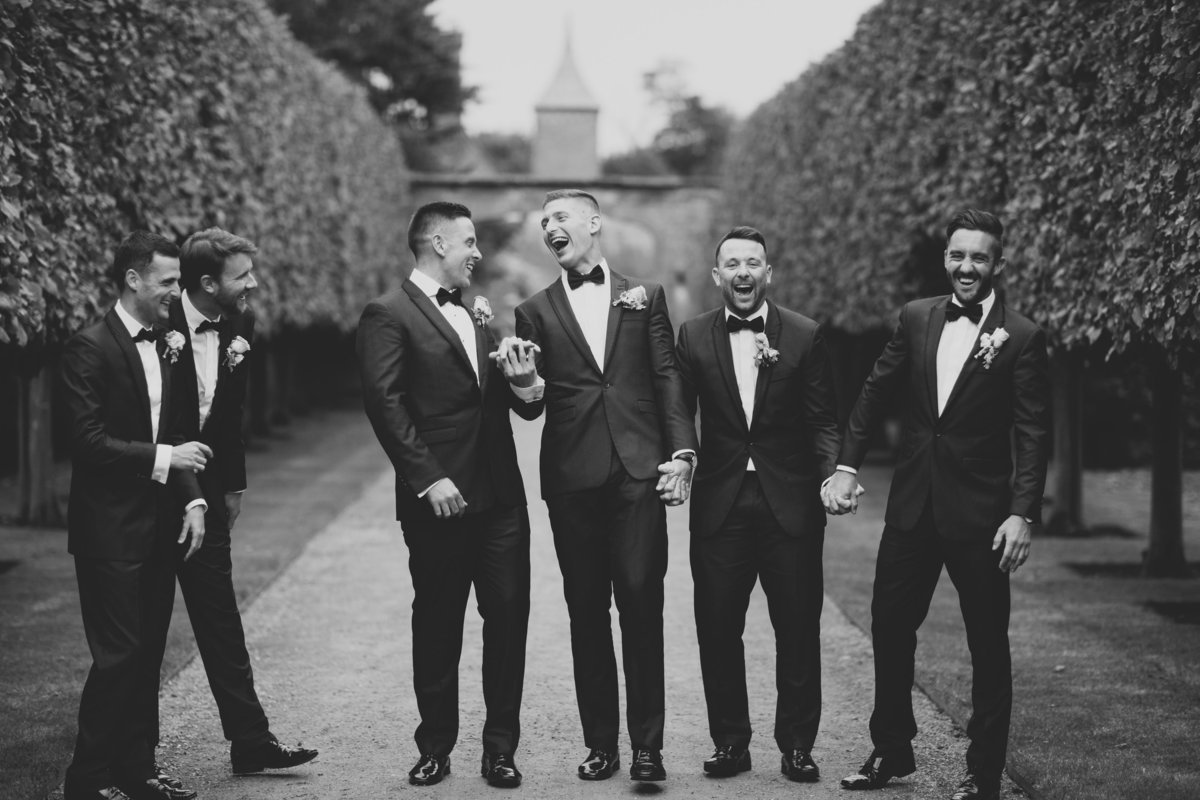 groomsmen laughing hands