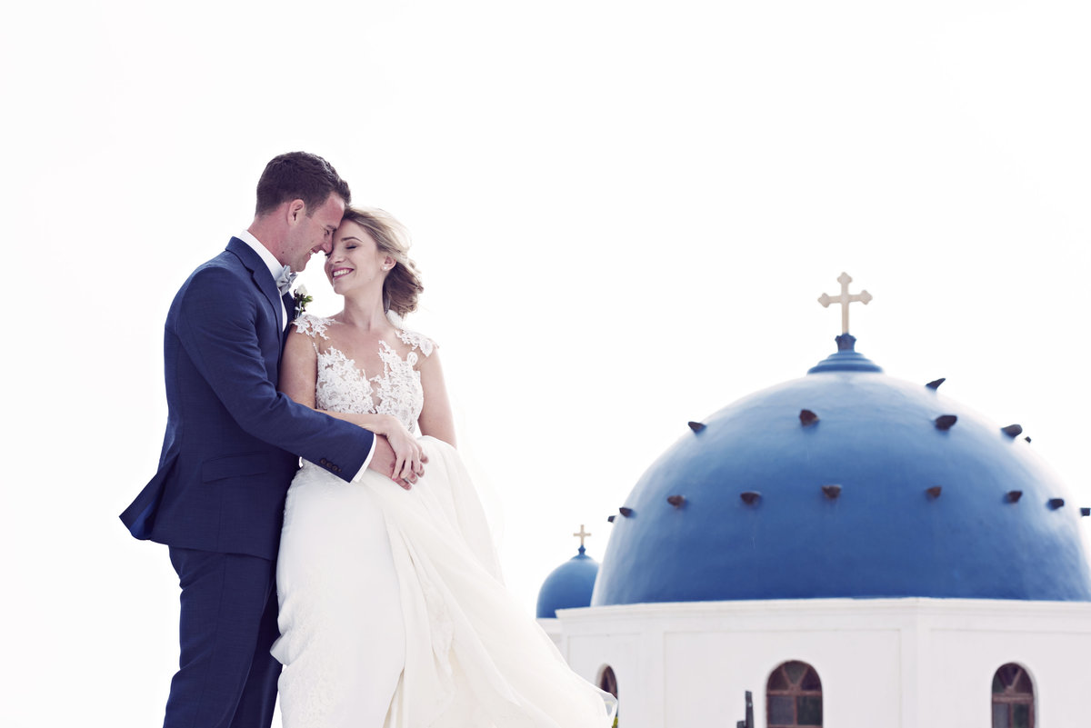 Bride and Groom stood by the Blue Domes in Santorini