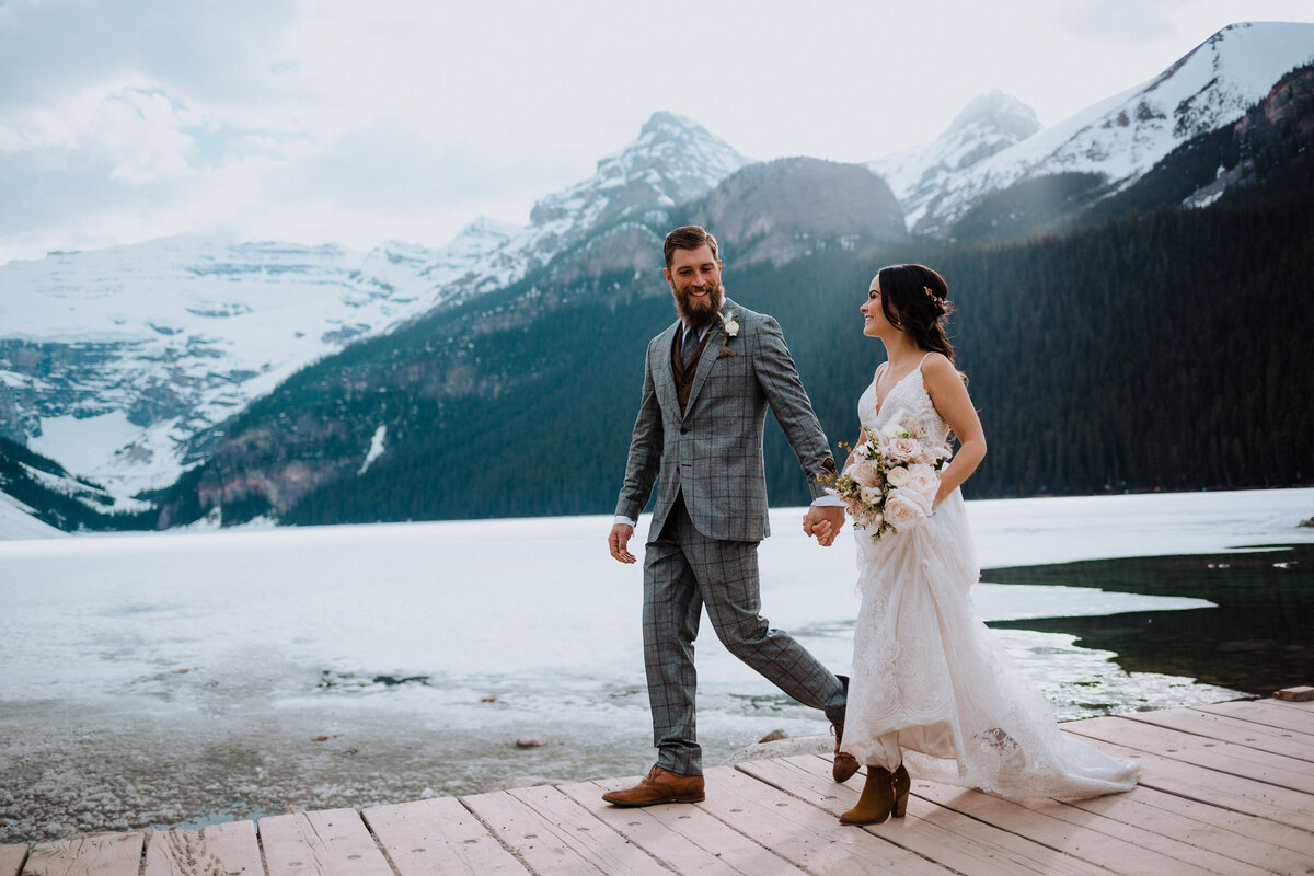 Couple walking in front of lake louise
