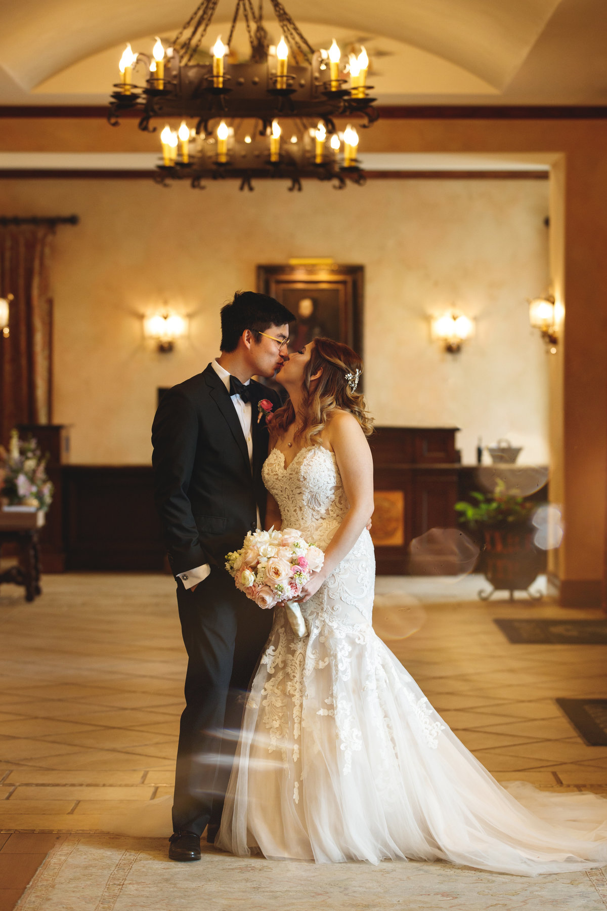 hotel granduca wedding photographer bride groom kiss asian vietnamese lobby 320 S Capital of Texas Hwy, West Lake Hills, TX 78746