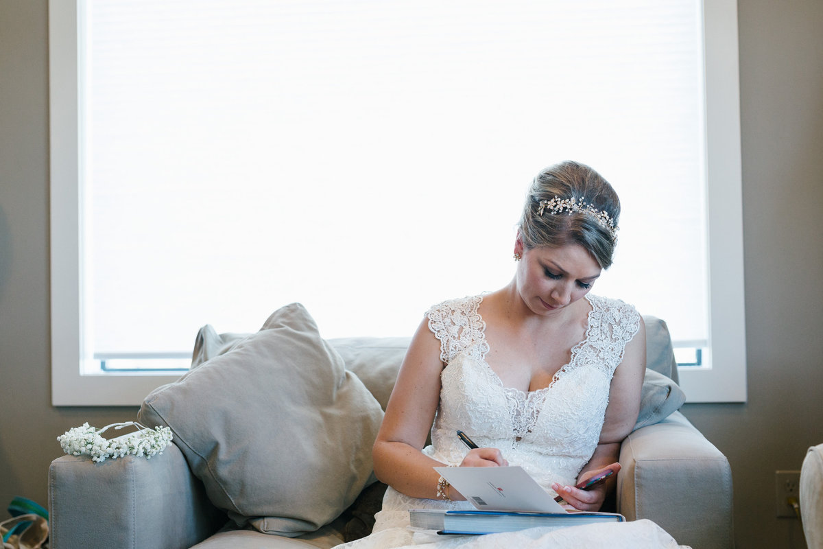 Bride reading a letter from groom before ceremony during getting ready at Paniolo Ranch venue in Texas Hill Country