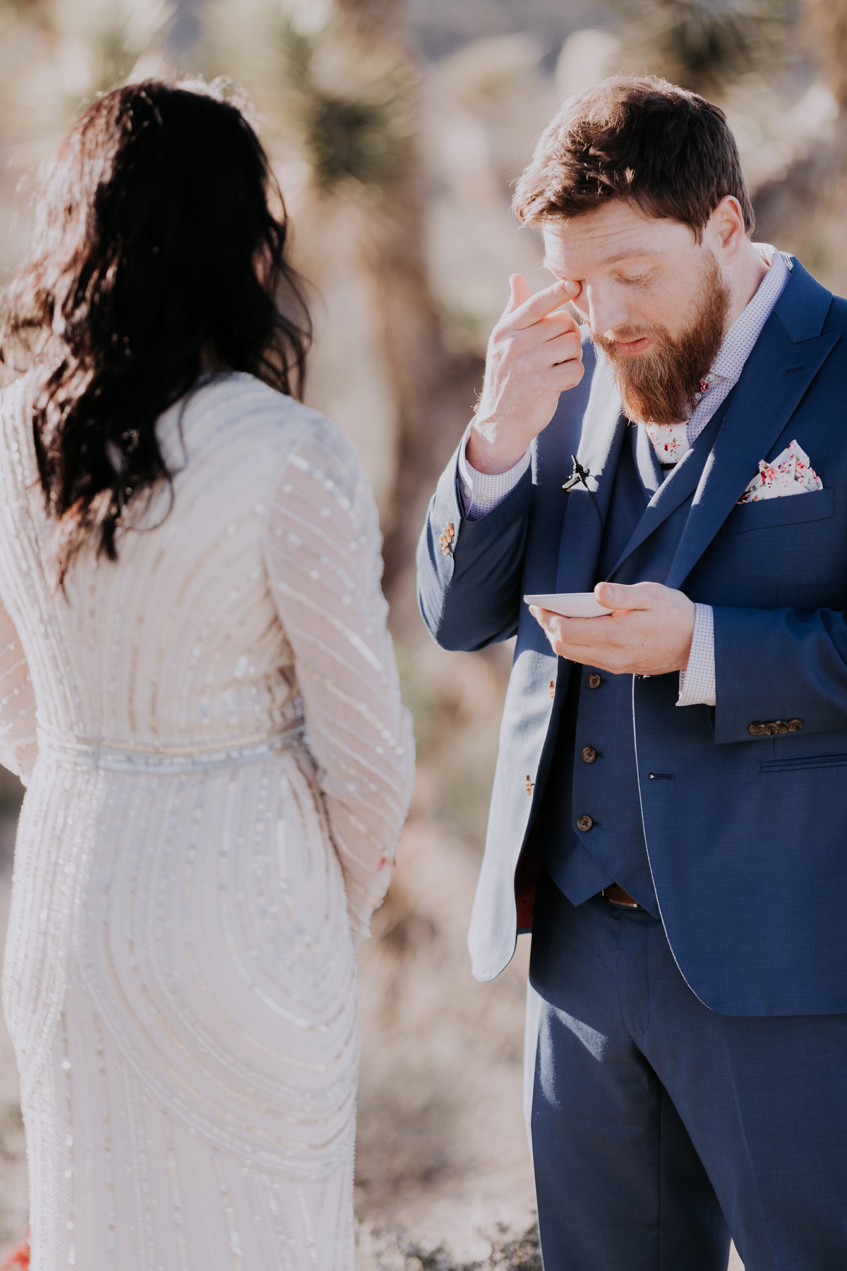 Lake Tahoe elopement pictures groom cries as he reads vows
