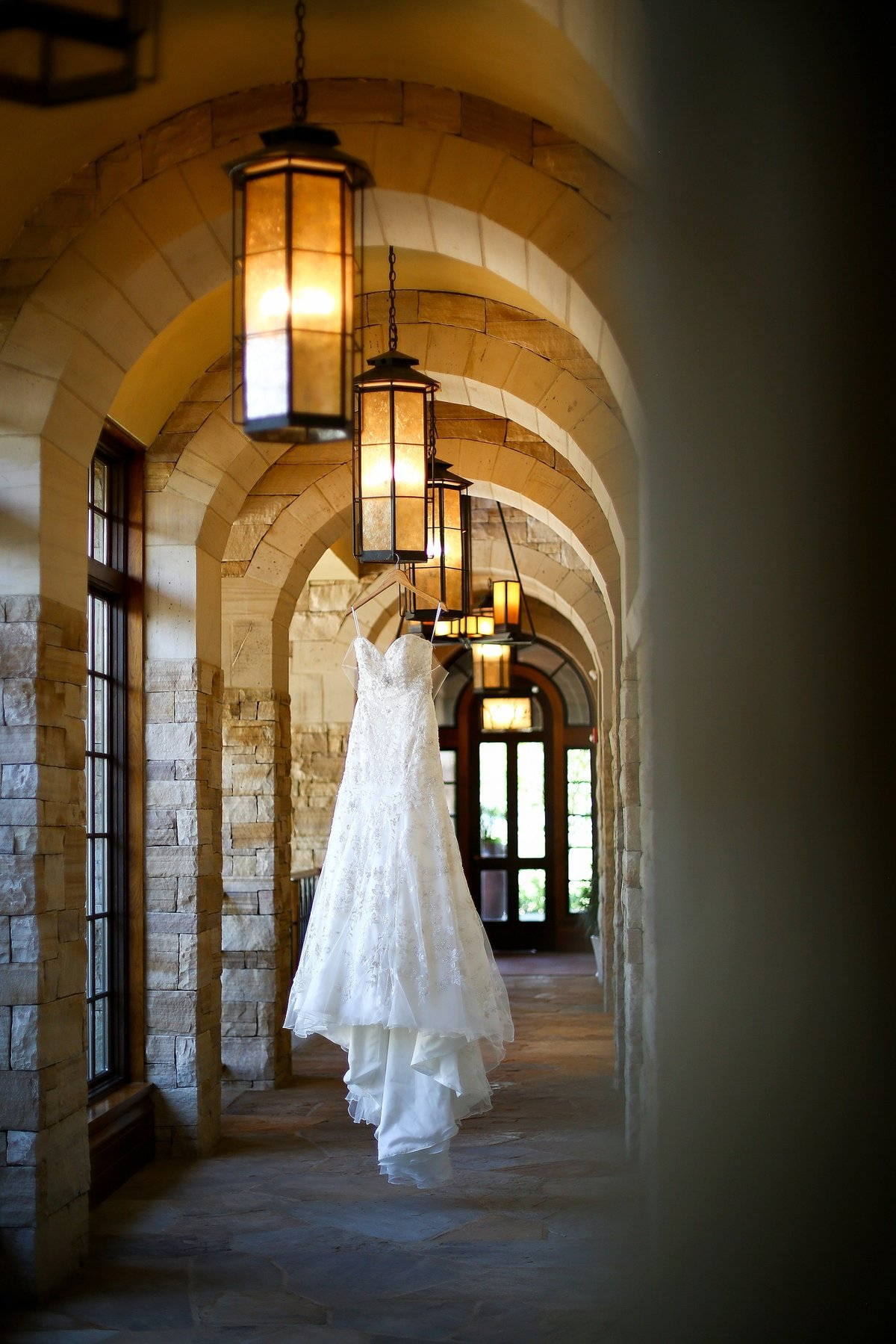 Wedding dress hanging in hallway at the sanctuary golf course