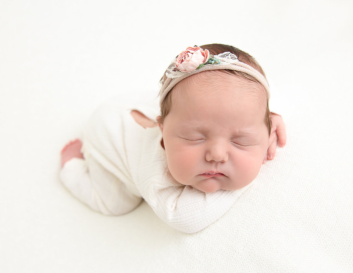 Posed newborn girl at our in-home studio in Rochester, Ny.