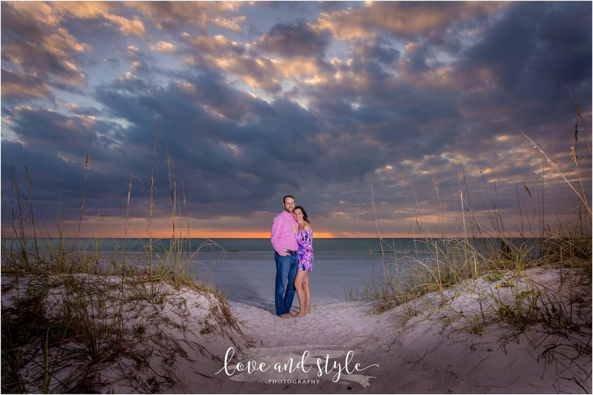 Anna Maria Island Engagement Photography of couple at sunset between sand dunes