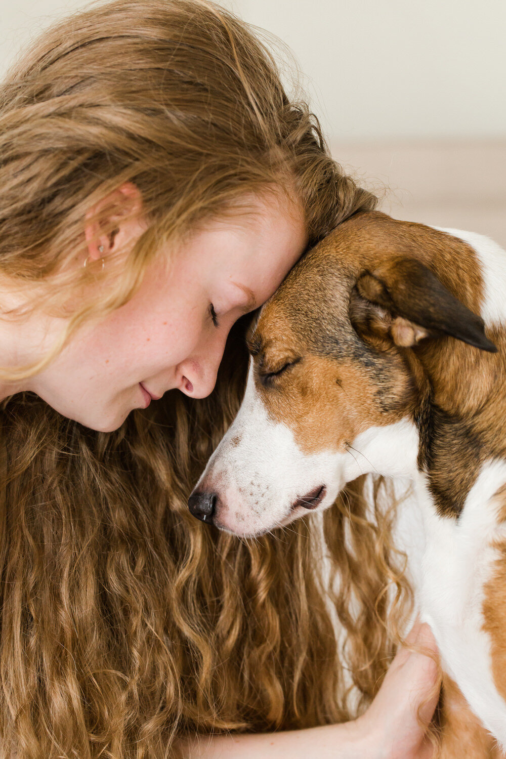 sweet photo of girl and dog in studio