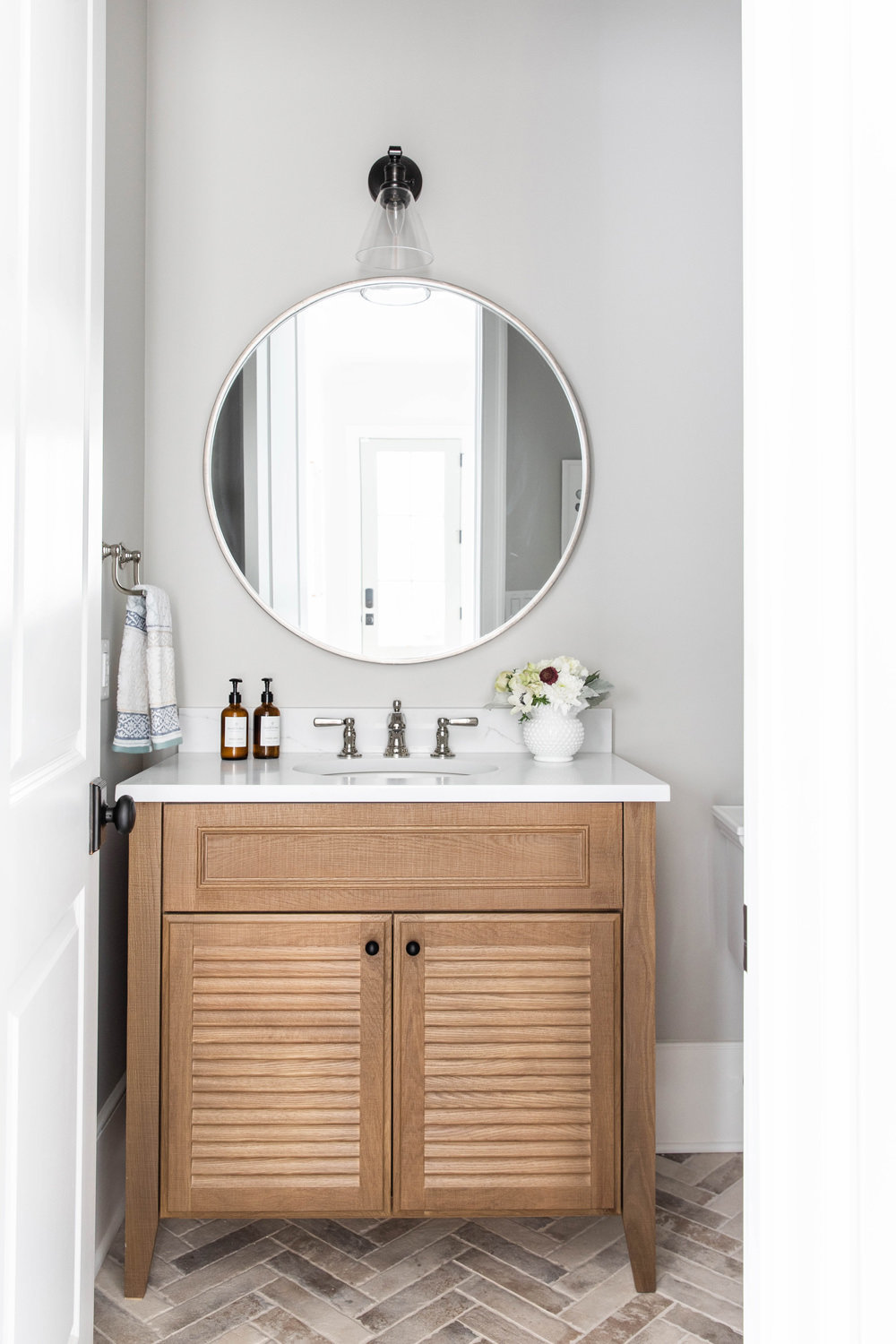 White-Oak-Louvered-Vanity-with-brick-herringbone-floor-1