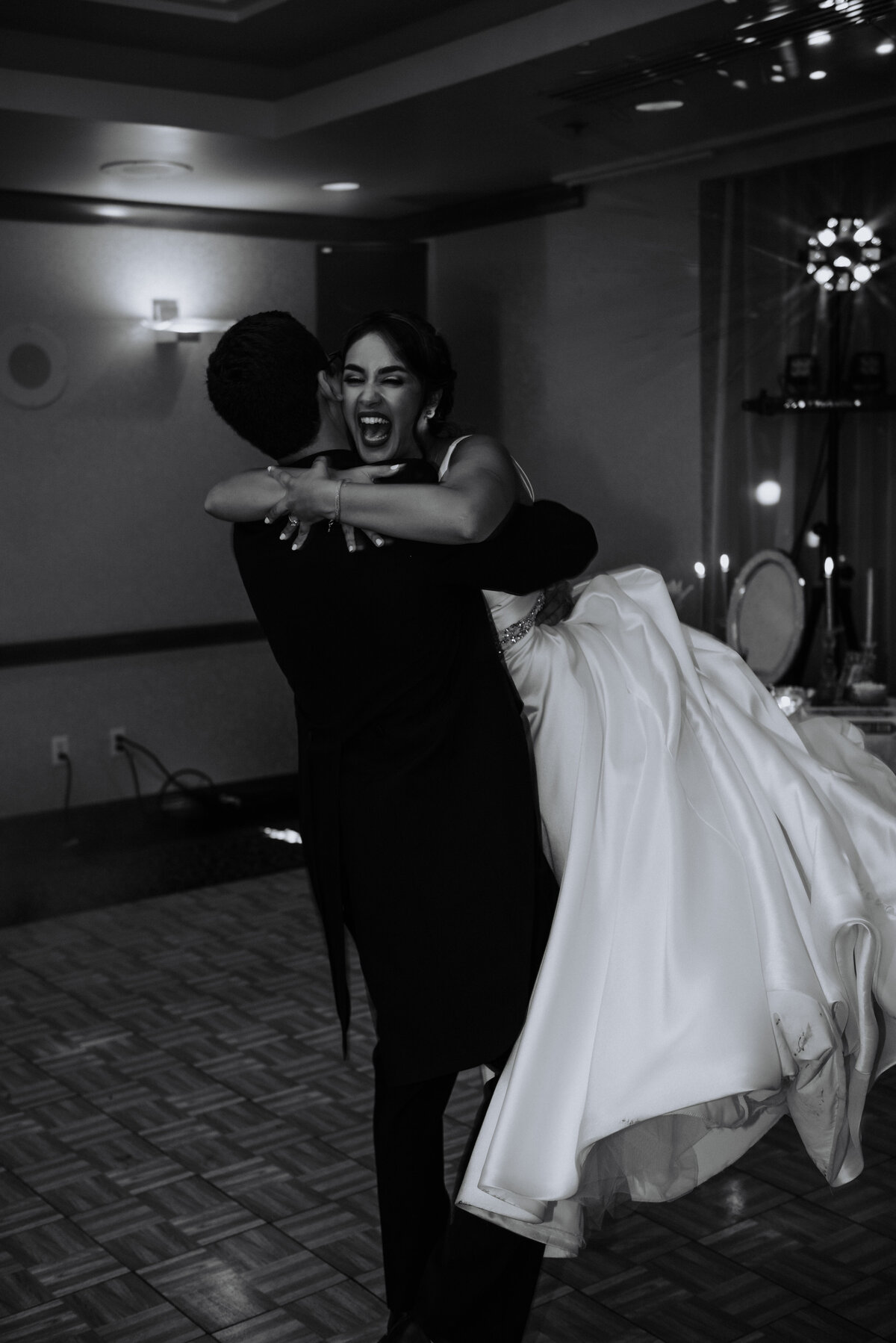 Couple's first dance, spinning around, black and white