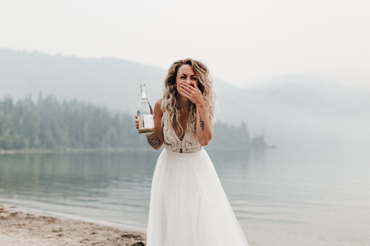 athena-and-camron-sara-truvelle-bridal-wenatchee-elopement-intimate-33-bride-drinking-champagne