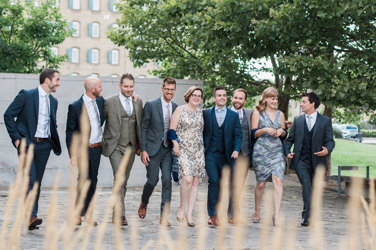 wedding party laughing together and walking