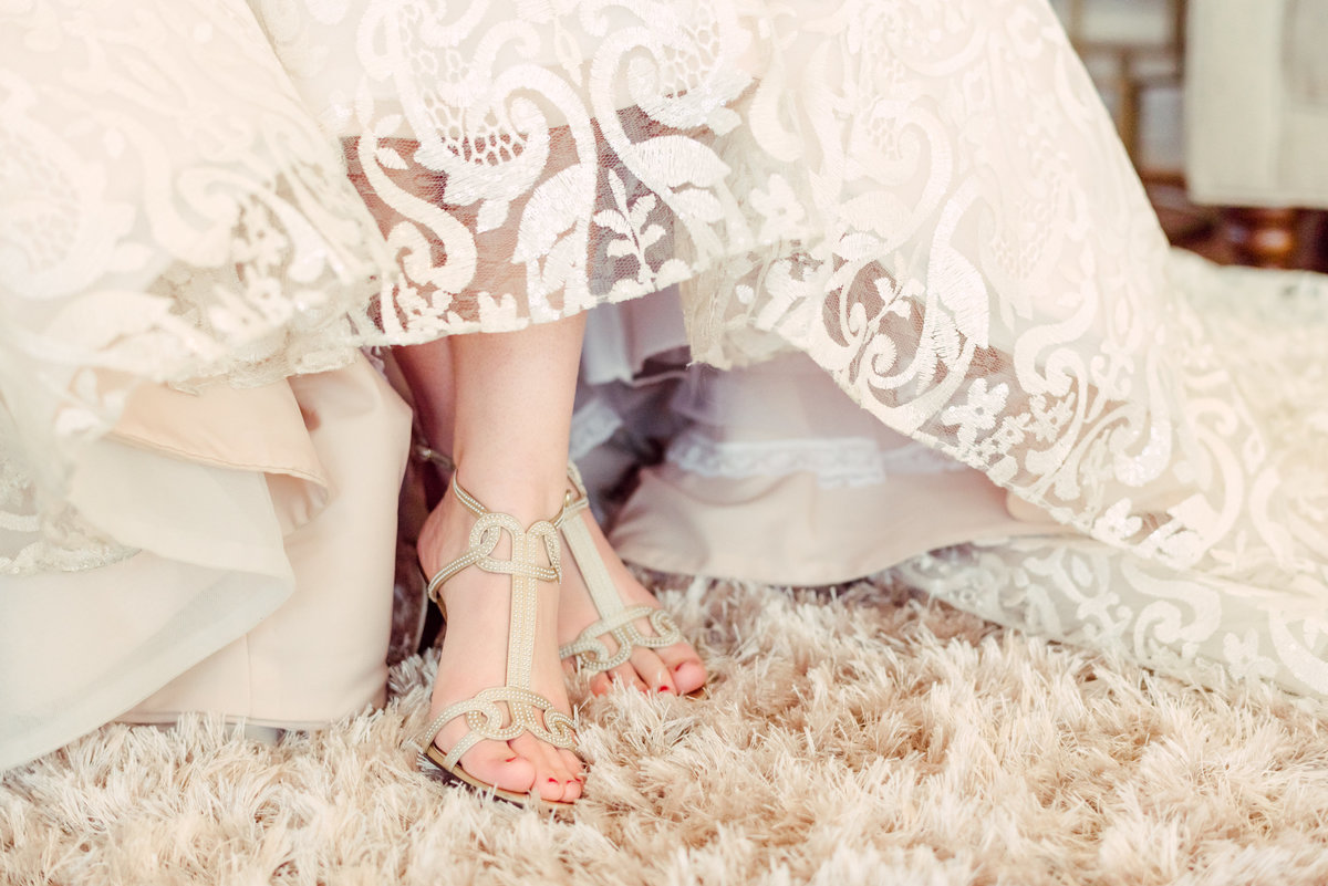 bride with cream bridal shoes