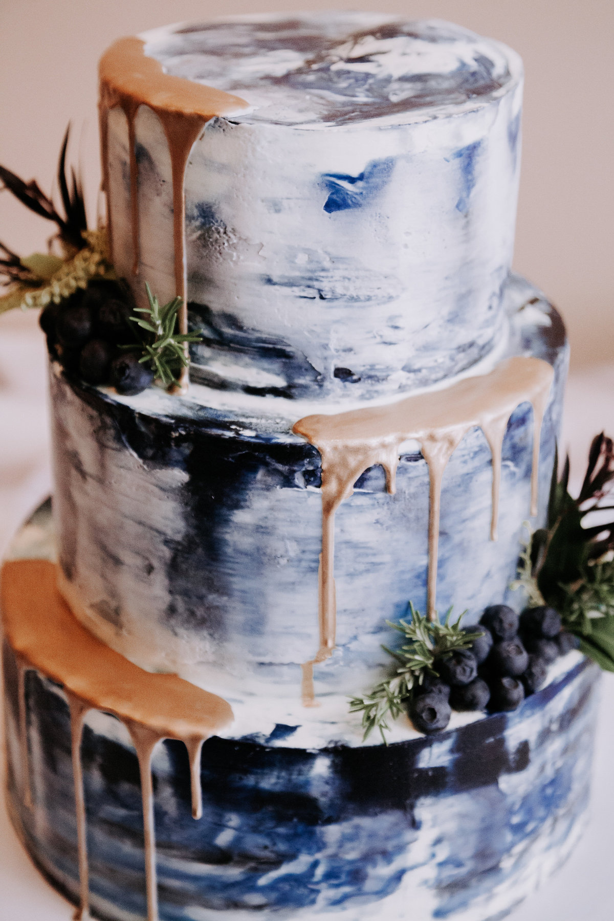 Lake Tahoe wedding pictures royal blue and gold cake on display