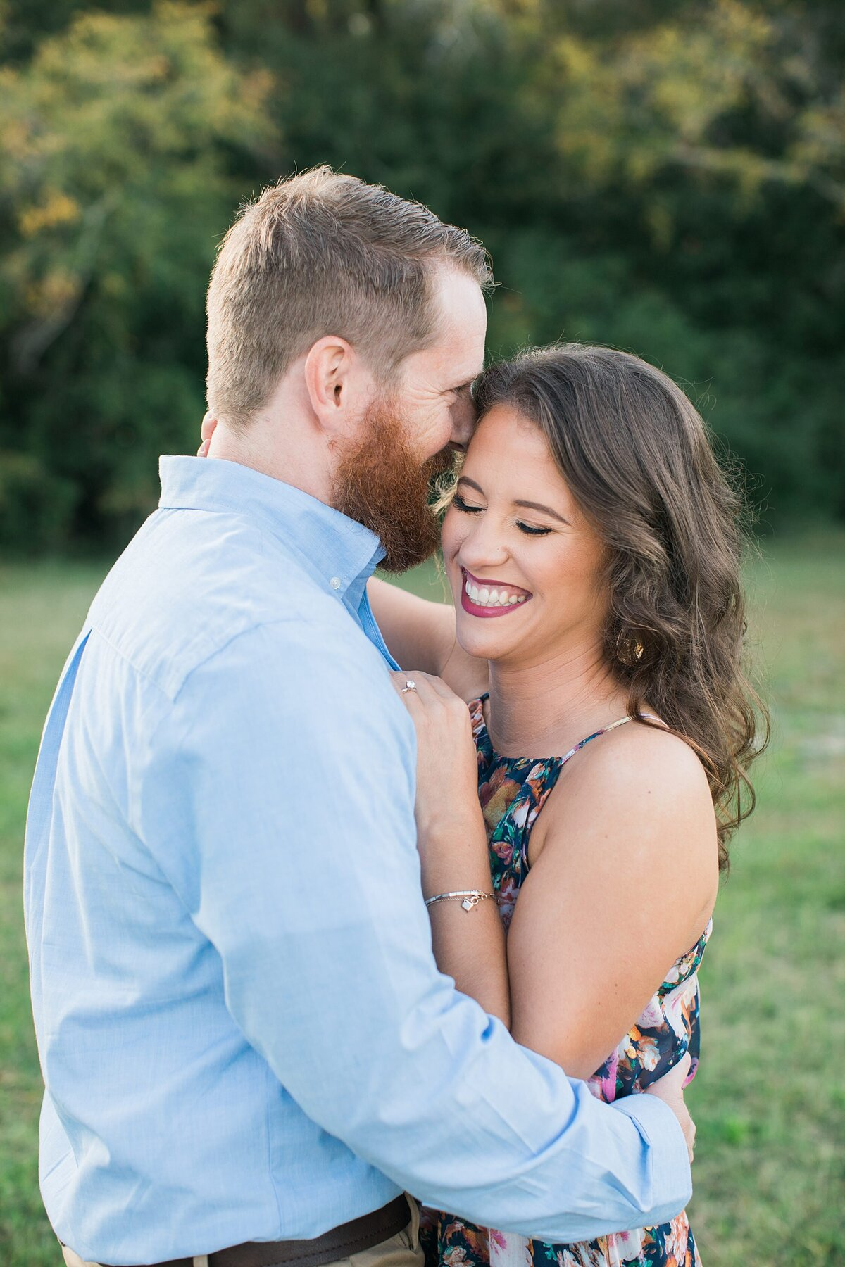 Greenville  Wedding Photographer, couple smiling and holding each other close