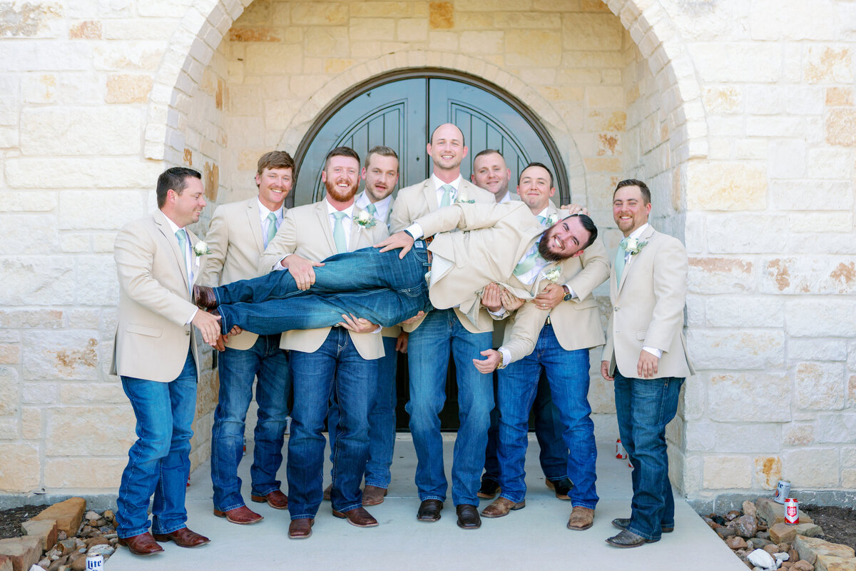 Groomsmen Goofing Off Holding the Groom