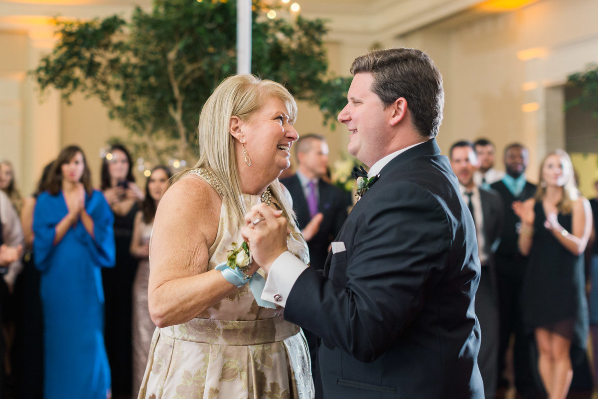 This mother son dance was both parts emotional and surprising! Photo by luxury destination wedding photographer Rebecca Cerasani.