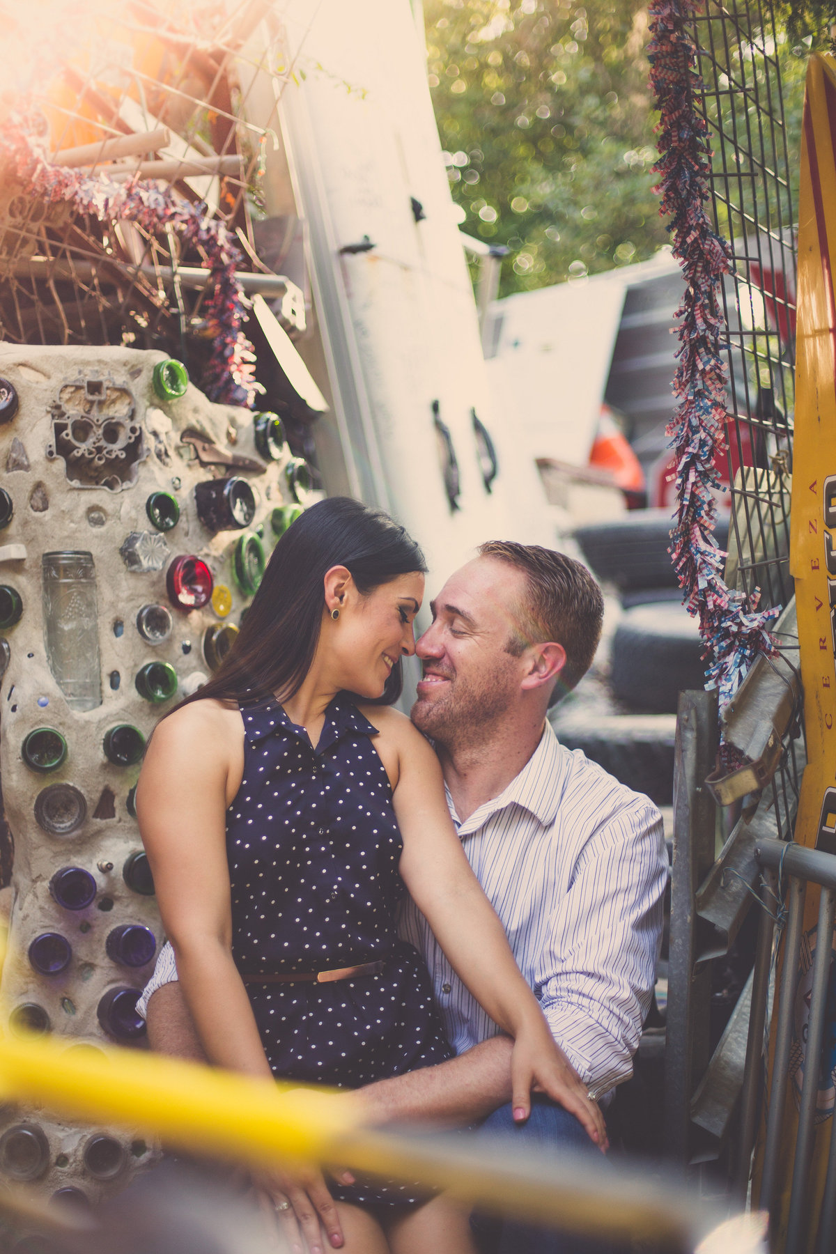Fiancé staring into his fiancée eyes at the Cathedral of Junk in Austin, TX at their engagement session by Expose The Heart.