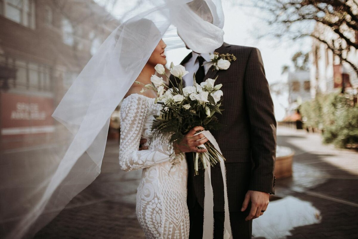 Outside-estate-on-second-venue-bride-and-groom-stand-together-artsy-photo