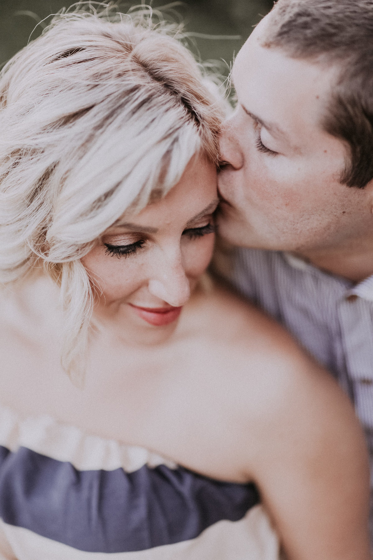 Lake Tahoe engagement pictures a groom kisses his bride