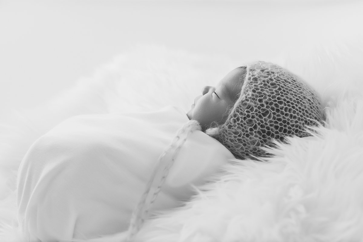 black and white side profile of baby boy sleeping swaddled {Milton Newborn Photographer}
