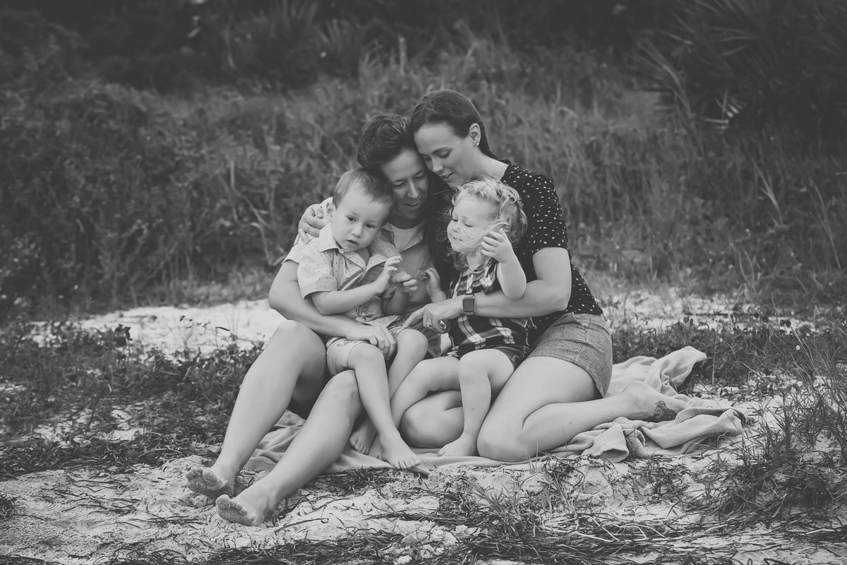 Black and White Family Snuggle Gulf Breeze