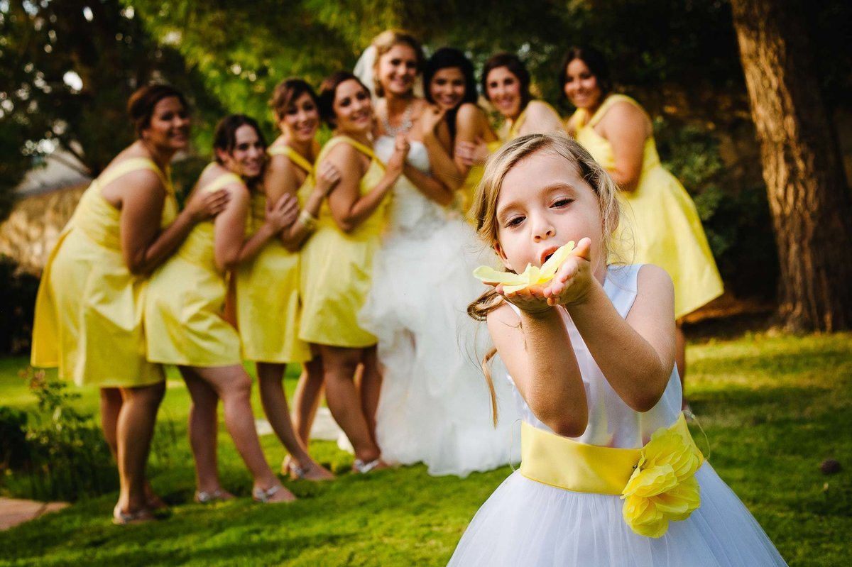 flower girl with yellow dress by stephane lemaire photography