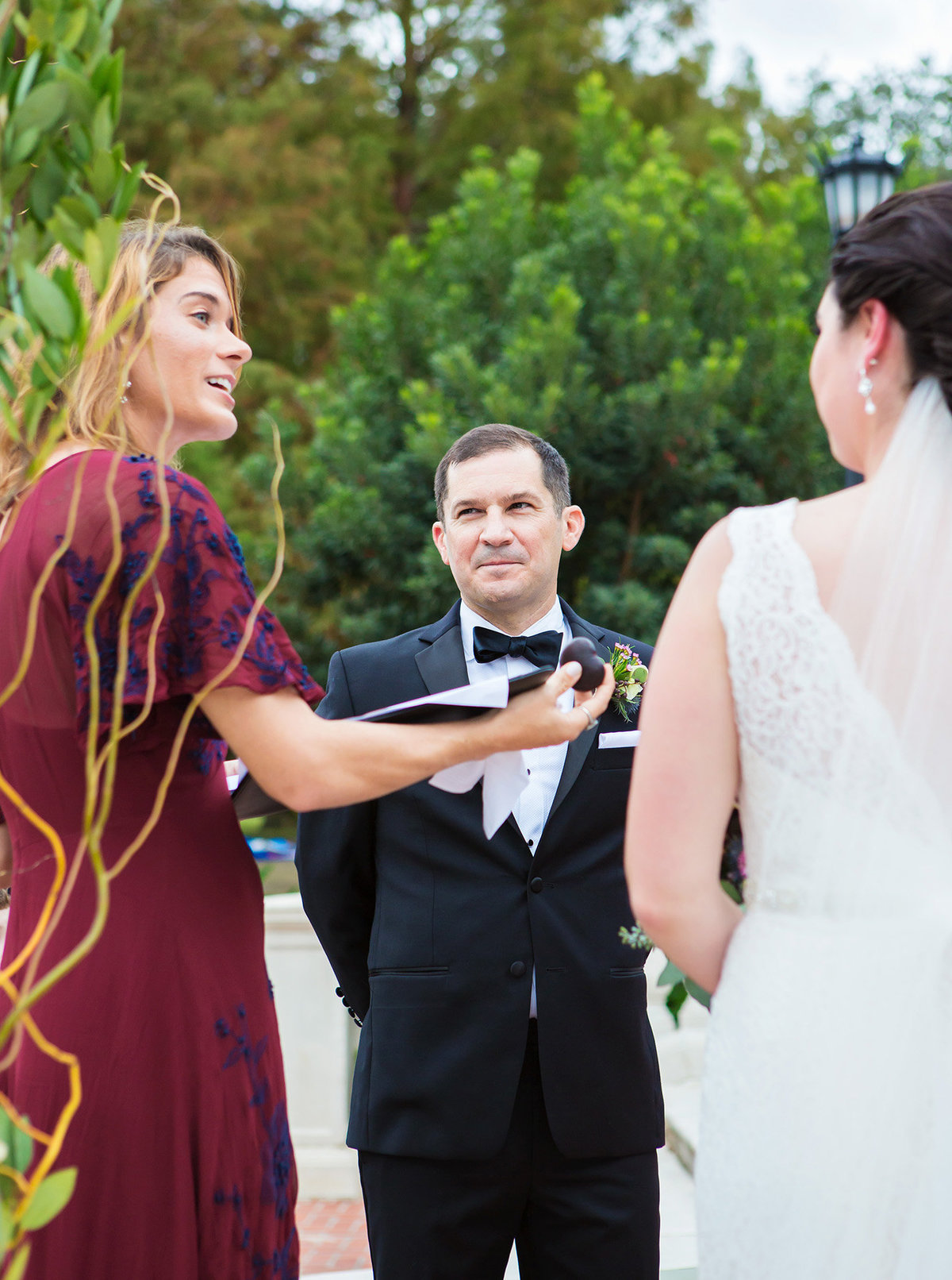 nola officiant holding heart shaped rock out to wedding couple during vows