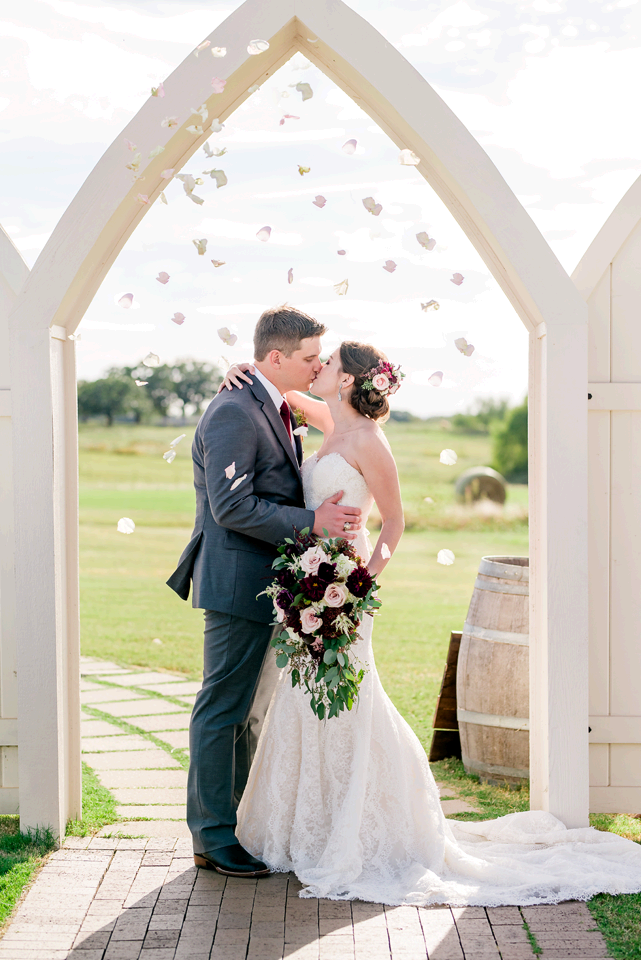 Couple Posing at Dallas wedding venue by Dallas Wedding Photographers