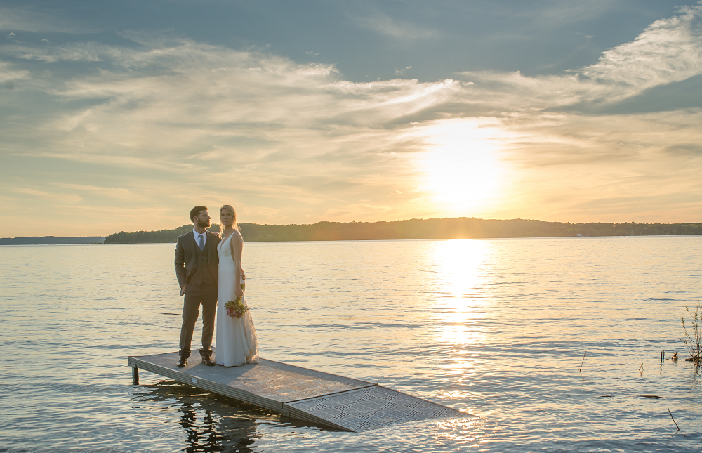 DESTINATION WEDDING IN TRAVERSE CITY WITH KRISTEN AND SCOTT Bride and Groom on Dock