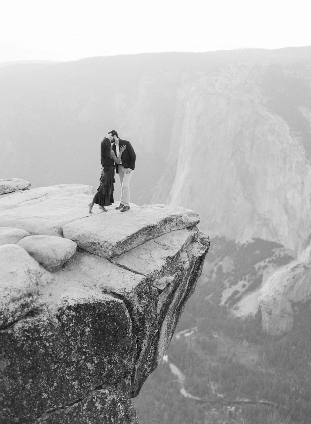 48-KTMerry-weddings-engagement-photography-Yosemite-cliff-black-white