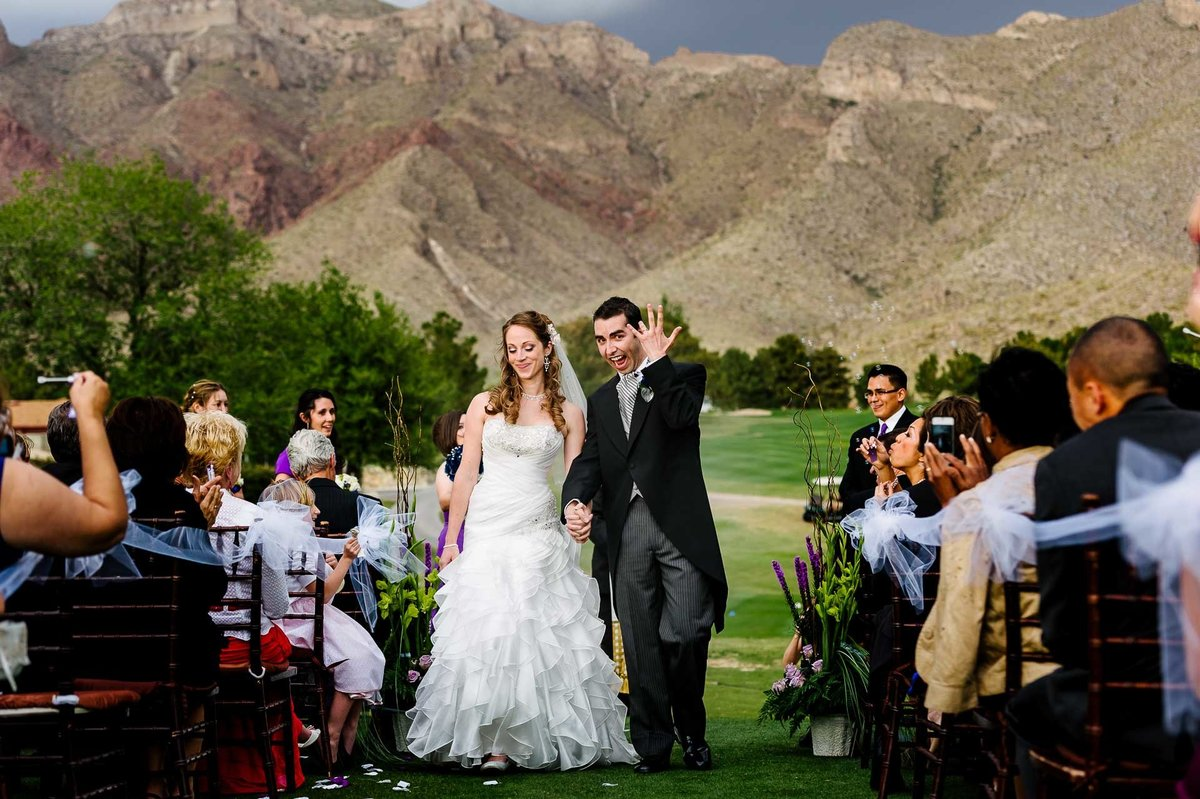 bride and groom walking down the aisle at coronado country club  in el paso by stephane lemaire photography