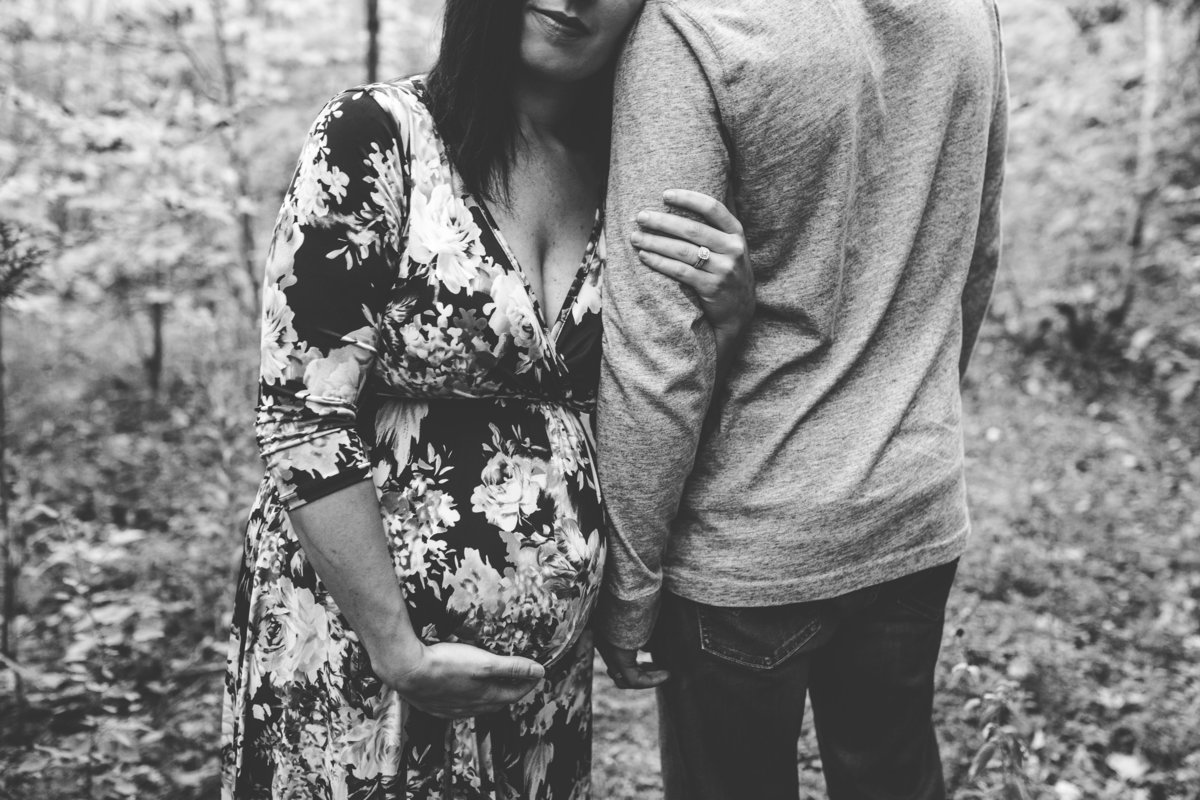 close up of pregnant couple embracing in forest {Oakville Maternity Photographer}