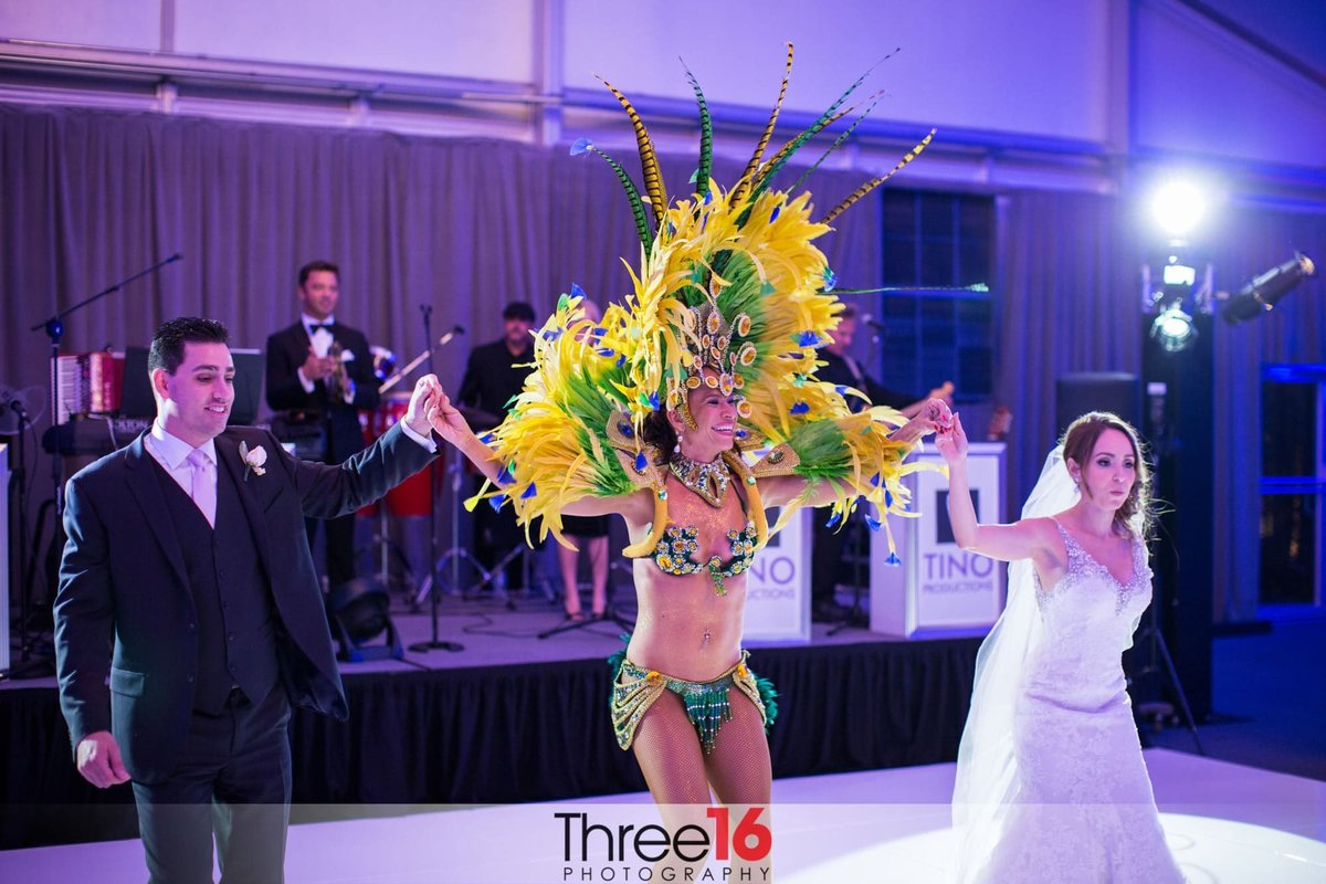 Mayan dancer joins the newly married couple on the dance floor at the Hotel Maya