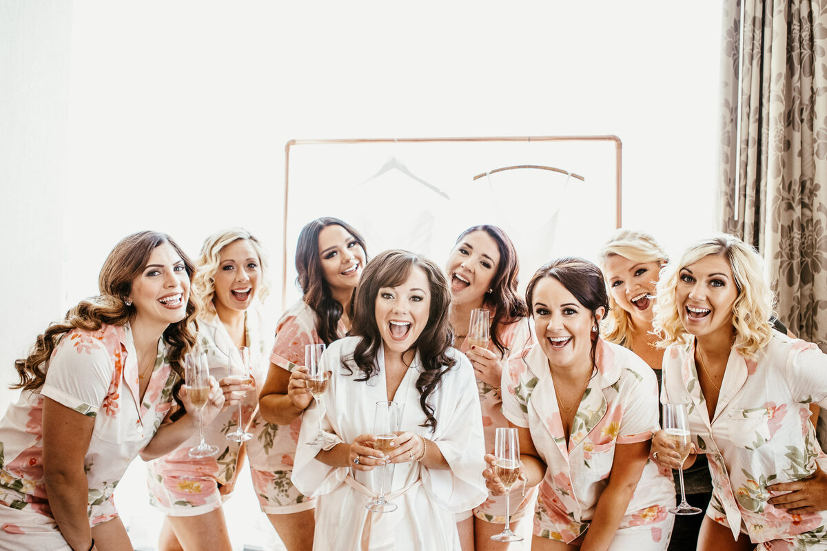 Bridal party getting ready for wedding with champagne in Buffalo, New York