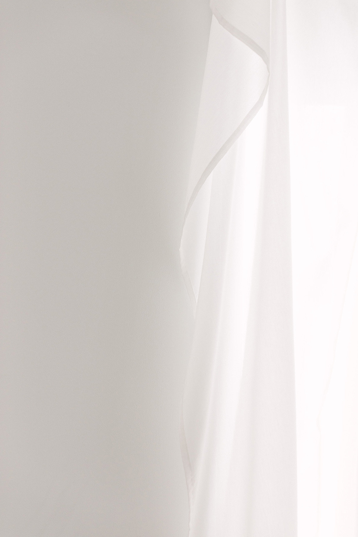 white curtains in a white studio space by Boudoir by Elle
