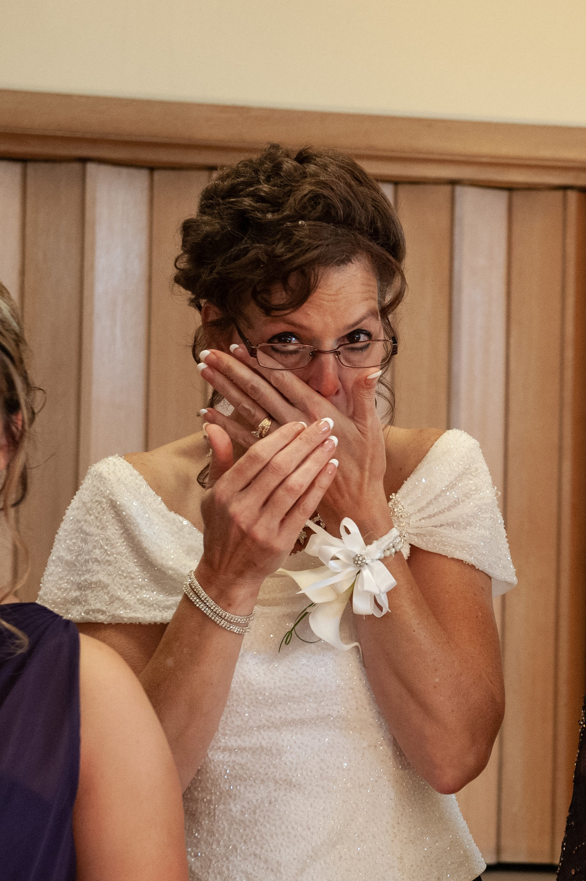 mother cries picture of corsage