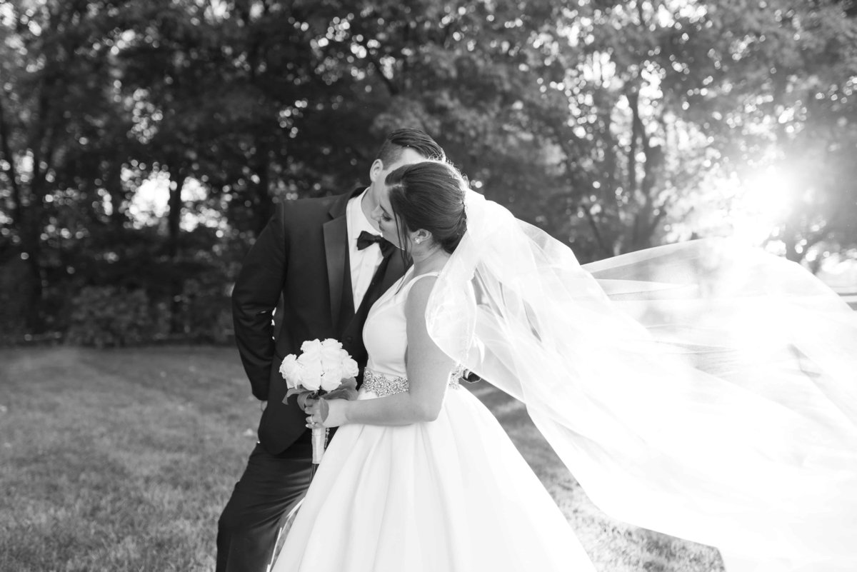 Black and White wedding portrait during sunset.