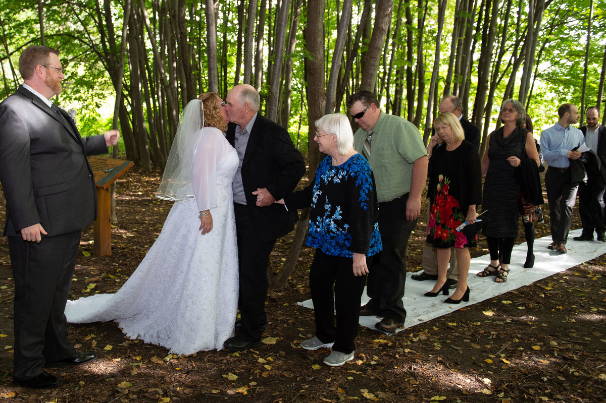 receiving line at wedding in the woods