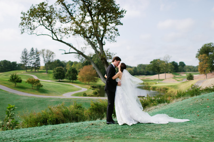 Bride-Groom-Kissing-Golf-Course-Congressional-Country-Club.