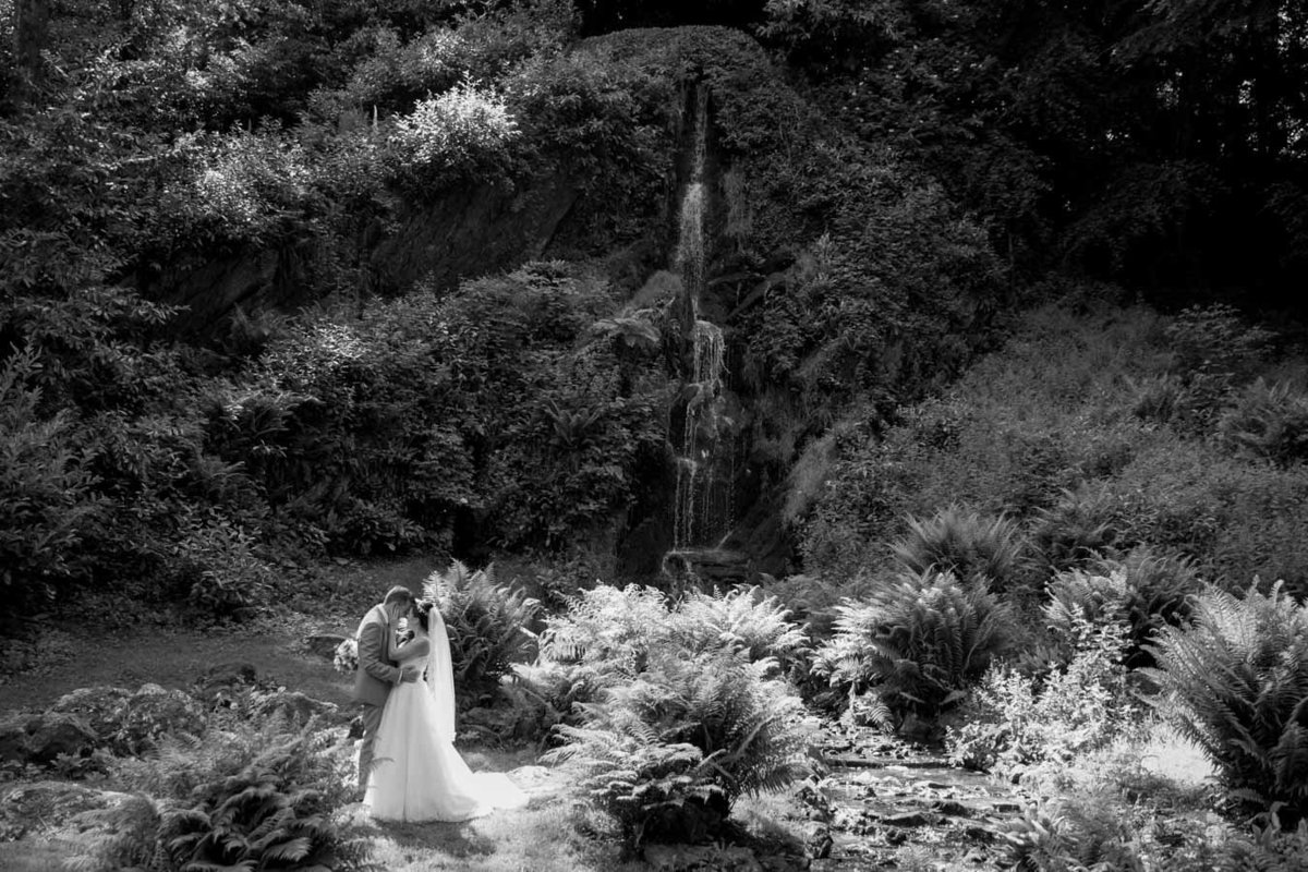 Black and white of Bride and Groom at cascade Hestercombe Gardens