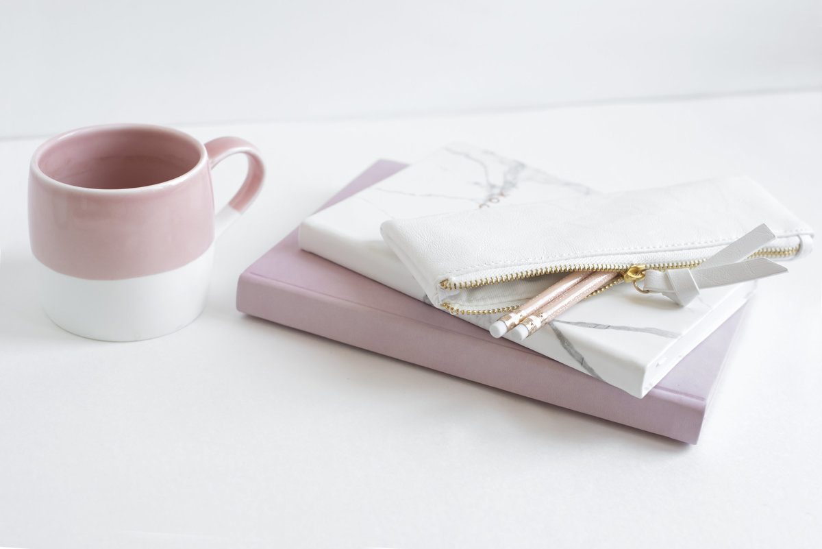 Pink mug and notebooks for Fort Worth Small Business Mentoring