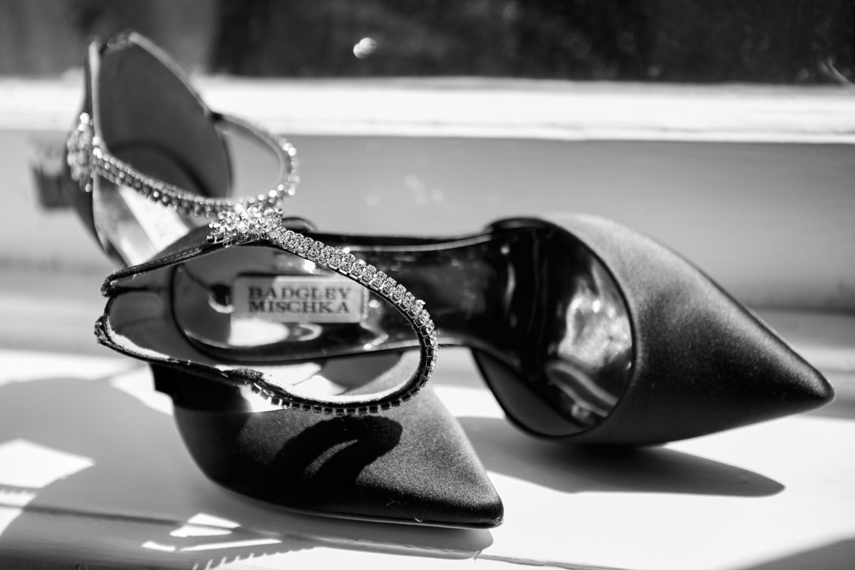 Black and white Badgley Mischka jeweled shoes sitting on a window sill at the Gastonian, Savannah, GA